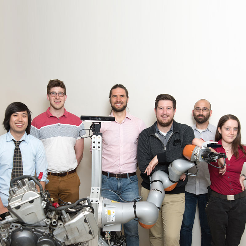 Draper developed a robot that can sense its environment, earning a spot as a KUKA Innovation Award finalist. Pictured L-R is Jay M. Wong, Justin Rooney, David M. S. Johnson, Mitchell Hebert, Abraham Schneider and Syler Wagner. (Not pictured: Rahul Chipalk