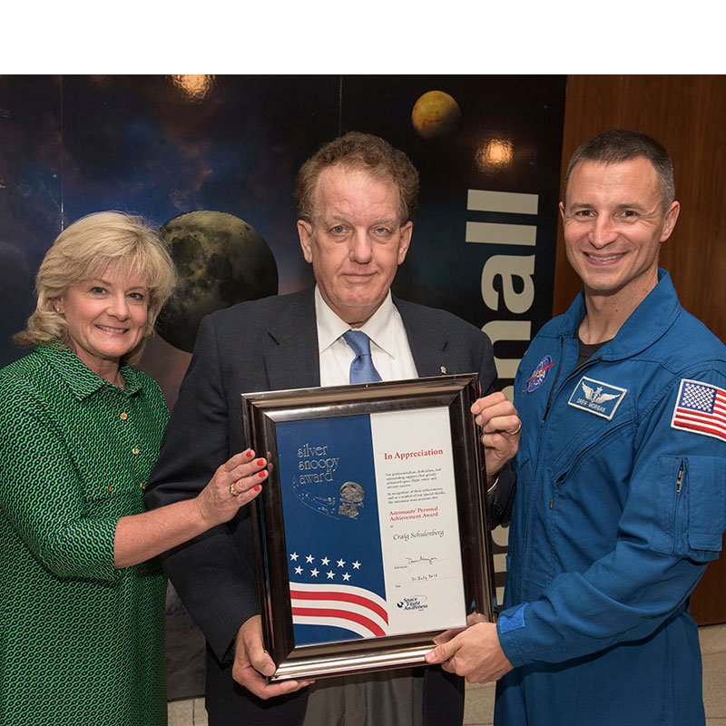 Craig Schulenberg (center) was honored with the NASA Silver Snoopy award, presented by Astronaut Andrew Morgan and Jody Singer, Deputy Director, MSFC.  Photo Credit: Fred Deaton, Marshall Space Flight Center