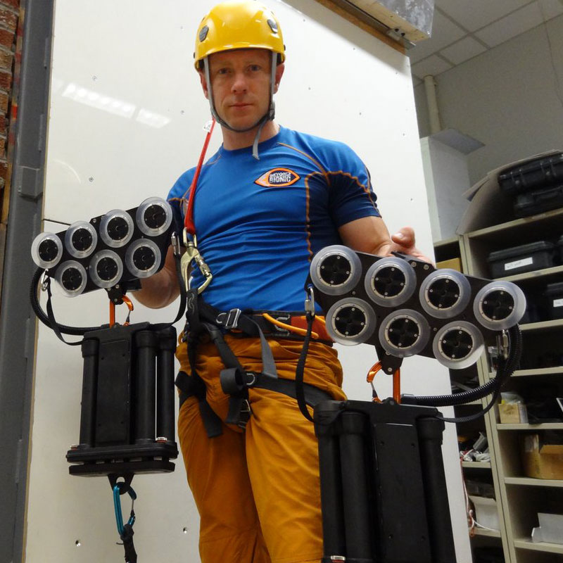 Action adventurer Andy Torbet tries out Draper's Z-Man climbing system before scaling the glass exterior of EF's 10 story building in Cambridge, Massachusetts.