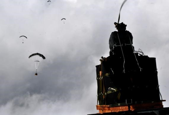 (Army photo) a JPADs pallet lands on target, followed by several others still in the air, during recent testing.