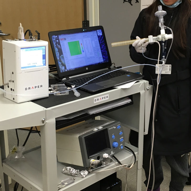 Draper's solution for rapid diagnosis of invasive aspergillosis integrates the company's microAnalyzer (top left) with a pressure sensor and breath sampling tube.