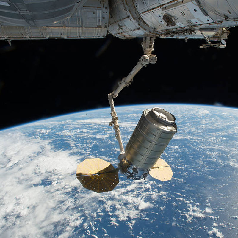 Orbital ATK's Cygnus cargo spacecraft is captured using the Canadarm2 robotic arm on the International Space Station. Photo Credit: NASA