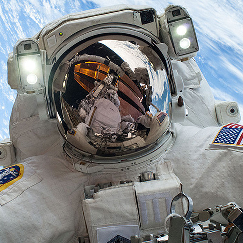 "Draper earned a patent for its ""take me home"" button for astronaut spacesuits. (Credit: NASA)."