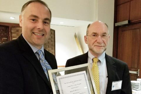 Almir Davis of Draper received the Boston Patent Law Association's 2017 Top Honoree Award from George Jakobsche, patent attorney at Sunstein Kann Murphy & Timbers. Photo credit: Boston Patent Law Association.